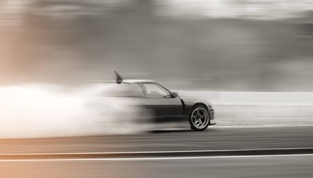 Motion speed car drifting on track. Blur image car drift and background. 스톡 콘텐츠