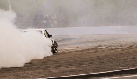Blurred of image diffusion race drift car with lots of smoke from burning rubber on speed track . Stock fotó