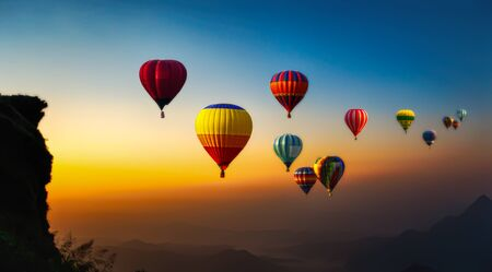 Hot air balloons flying over the sunrise mountain at phucheefa mountain. Chiang Rai Province, Thailand