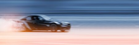 car drifting, Sport car wheel drifting and smoking on blurred background. Motorsport concept.