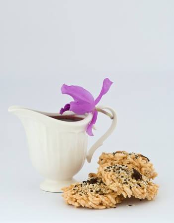 Crispy rice topping with sesame and cashew nut with roselle juice photo