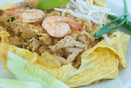 Shrimp Pad Thai wrapped with fried egg photo