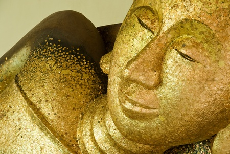 Close up of reclining buddha in Thailand photo