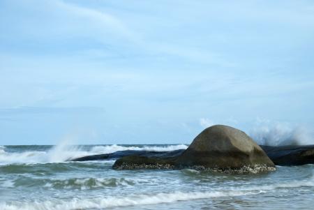 Surf breaking against rock on coastline Stock Photo - 14287902