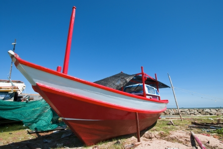 Old fishing boat parking on shore waitng for repair photo