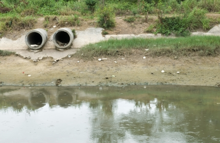 Concrete drain pipe, polluting to river photo