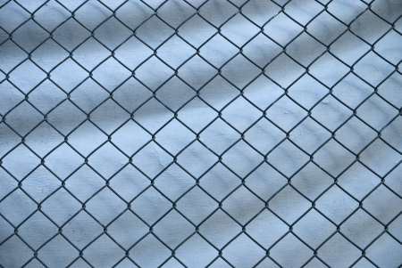 penal: Wire fench on white blanket background Stock Photo