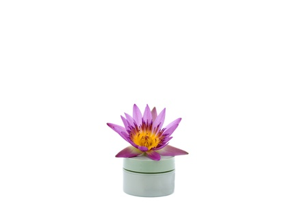 Water lily flower on cosmetic jar on white back ground Stock Photo - 15787955