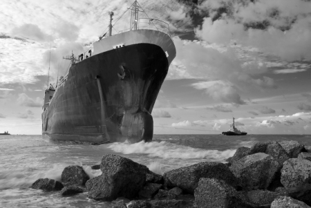 Cargo ship run aground on rocky shore waiting for rescue Stock Photo - 23085028
