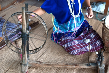 Housewife weave cotton cloth in Thailand  photo