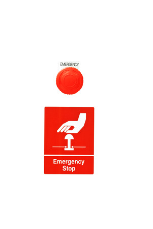 Emergency stop button on white background photo