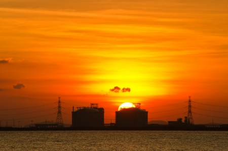 Dramatic sunset over tank farm in Thailand  photo