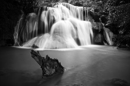cataract waterfall: Huay Mae Kamin , beautiful waterfall in green forest, black and white