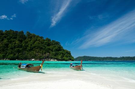 island beach: Boat waiting for tourist in clear sea and white sand beach at Lipe Island, Thailand