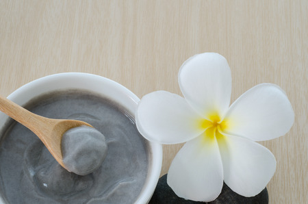 body spa: Natural mud mix in yogurt for spa treatment on wooden background