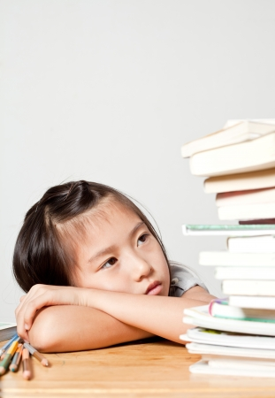 Girl is Tired for study  or with learning difficulty photo