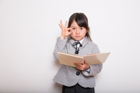 elementary age girls: A young school girl ready to Study   Hand