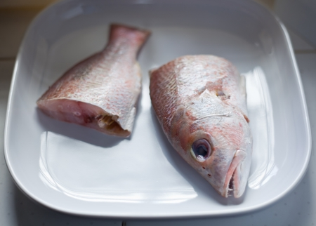 half cut: Image of half cut fresh red fish ready to cook