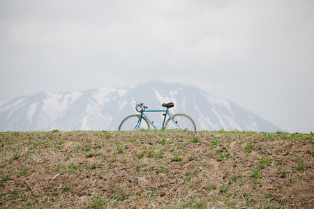 A bicycle parking on mountain background 写真素材