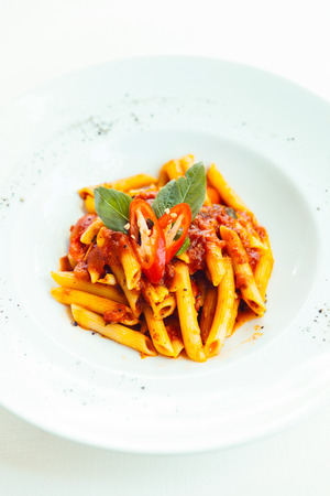 ingradient: penne with tomato sauce on white dish Stock Photo