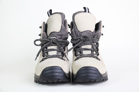 mountain climbing: hiking shoes on white background