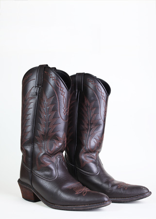 cowboy leather boots on white background 写真素材