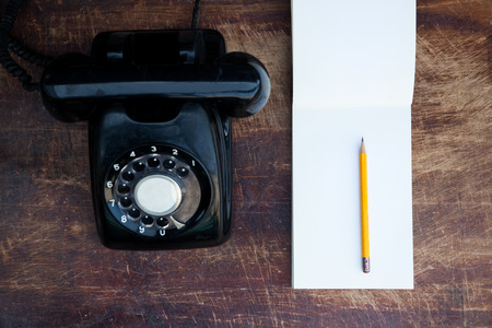 memo pad: vintage telephone and memo pad on rustic table