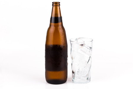 taphouse: Glass of beer on ice on white background