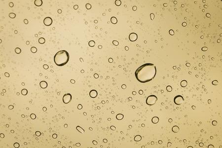 kropla deszczu: Raindrop on mirror with color filter golden