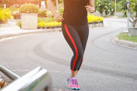 young fitness woman running in the park.