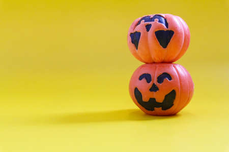 Halloween pumpkins on the yellow paper background. Halloween background. Space for text. copy space.