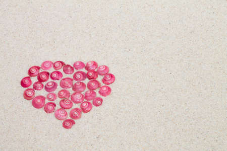 dearest: heart made by pink shells Stock Photo
