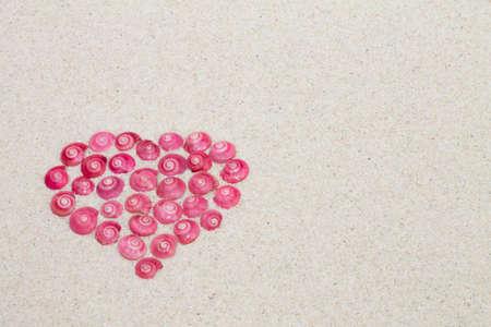 beach wedding: heart made by pink shells Stock Photo
