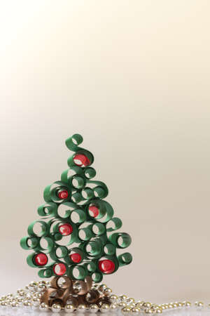 quilled shapes: christmas tree from curled  paper strip Stock Photo