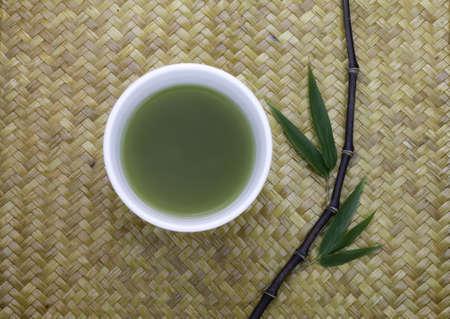 tea hot drink: matcha green tea bowl cup and black bamboo