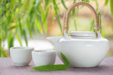 matcha: green tea bowl cup with bamboo as background Stock Photo