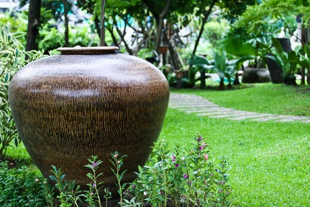 Landscaping with a fountain jar. For the season Stock Photo