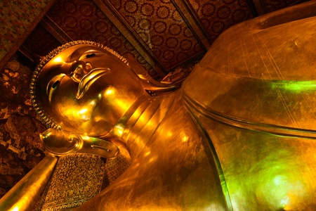 Reclining Buddha statue in Thailand Buddha Temple Wat Pho , Asian style Buddha Art Editorial