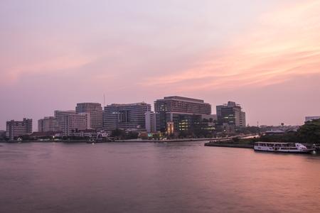 praya: Twilight at Siriraj hospital with boat in Chao Praya river Editorial