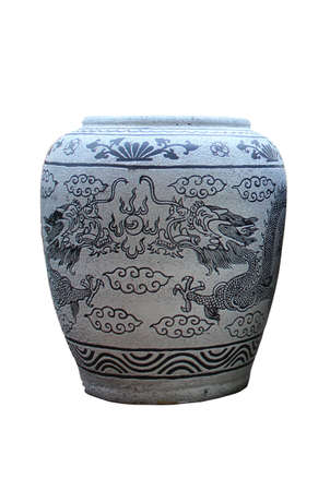 Glazed water jar with dragon pattern on white background photo