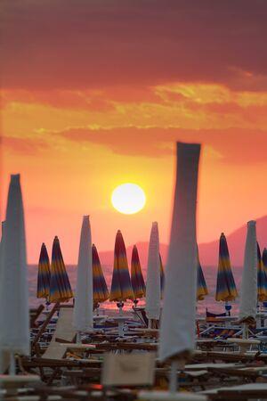 Dramatic sunset sunrise over the italian tirrenean coastline,Tuscany, Marina di Grosseto, Castiglione Della Pescaia, Italy. Stock Photo
