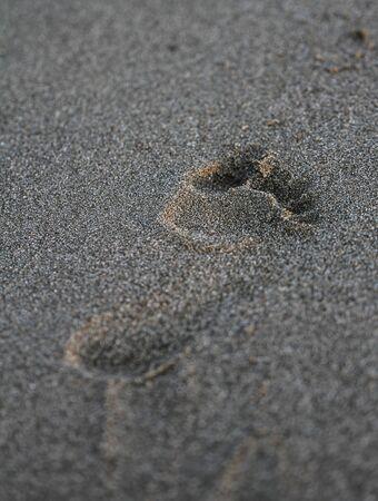 foot print on sand beach in italian tirrenean coastline,Tuscany, Marina di Grosseto, Castiglione Della Pescaia, Italy
