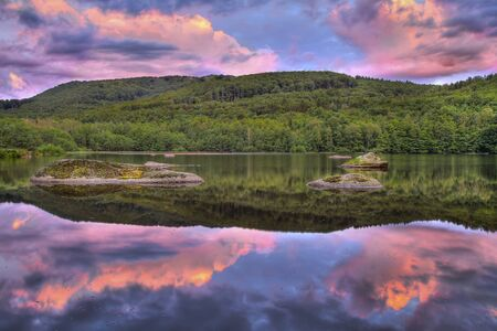 Wonderful sunset sunrise over landscape mirroring in the water surface, the best photo
