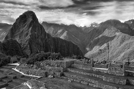 Machu Picchu, Peru. The ancient Inca city, located on Peru at the mountain an altitude of 2,450 metersl, dominating the valley of the Urubamba River. Awarded of the New Wonder of the World. Imagens