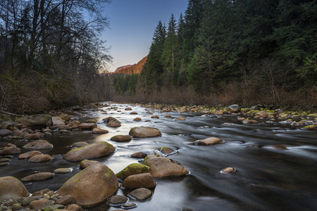 upstream: Upstream view of a shallow Seymour River with a long exposure on the water