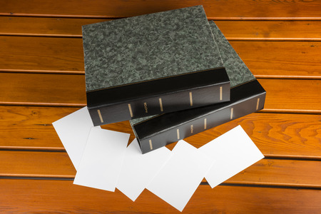 Two photo albums with blank photographs on a wooden table photo