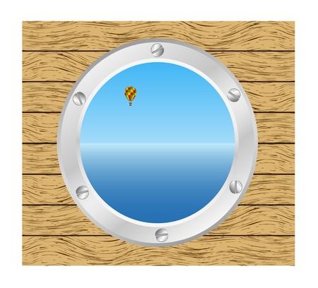 ventana ojo de buey: Mar y globo de aire caliente en una ventana del barco de plata - ojo de buey en una pared de madera
