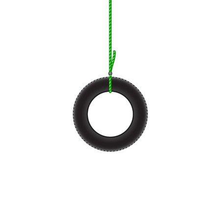car tire: Car tire hanging on green rope