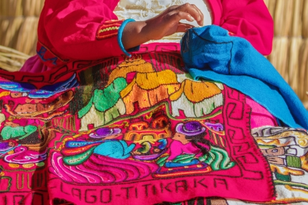 Woman sewing in Uros, Peru, Bolivia Stock Photo