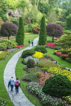 People walking through park in Butchart Gardens Stock Photo